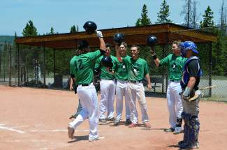 Logan Bima is greeted with high-fives after rocking a grand slam in game one of a doubleheader against the Vail Vipers last summer in Frisco. The college team returns for its second season this summer and is in need of local host families for players and coaches.