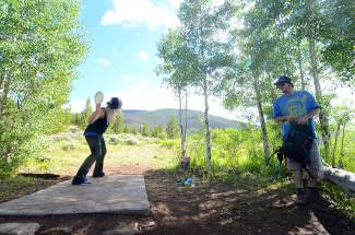 Summit Cove residents Jessica Leach and Robbie Forbes on Hole 1 of the Lake Dillon Disc Golf Course. The course was recently upgraded to include concrete tee boxes and distinct trails from hole to hole.
