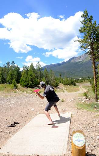 Summit County native Michael Ashforth drives Hole 1 at the Peak One Disc Golf Course in Frisco. The course is the oldest in Summit County and a favorite of veterans and beginners alike.