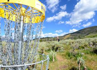 Jessica Leach of Summit Cove shoots for par on Hole 4 at the Lake Dillon Disc Golf Course on July 23.