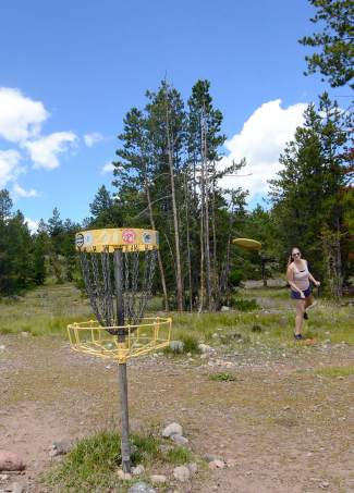 Dillon resident Audrey Kellogg goes for par on Hole 1 at the Peak One Disc Golf course in Frisco. The baskets are moved every few weeks, making the course fresh and unpredictable.
