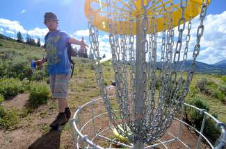 Robbie Forbes of Summit Cove sinks one for par on Hole 5 at the Lake Dillon Disc Golf Course.