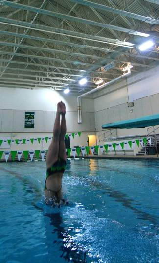 Summit's Laurel Bonner enters the water with perfect form during practice at the high school pool. Bonner is working on form and advanced dives in hopes of making the finals (and hopefully earning a podium finish) at the 4A Western Slope League Championships in Grand Junction Feb. 5-6.