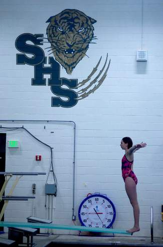 A Summit diver pauses before practicing back dives at the high school pool the week before 4A Western Slope League Championships. The eight girls on the team often compete against each other during regular meets because few other schools have a dive team.