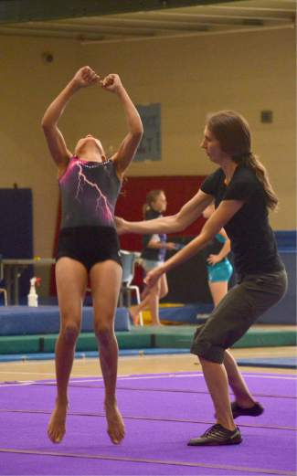 Scenes from open practice at the first Silverthorne Storm Gymnastics home meet of the summer, held yesterday and today at the Silverthorne Recreation Center. Roughly 35 members of the Storm team (in purple and black) compete against more than 120 youth gymnasts from the Front Range, with three levels of competition for athletes from 7 to 14 years old.