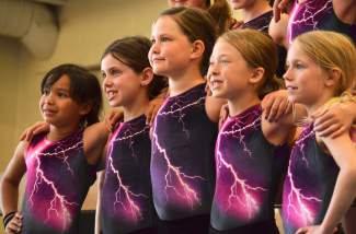 Members of the Silverthorne Storm gymnastics team smile for the camera during photo day in early June. The Storm's three competetive teams are paired with introductory classes and clinics, including parent and toddler tumbling classes.