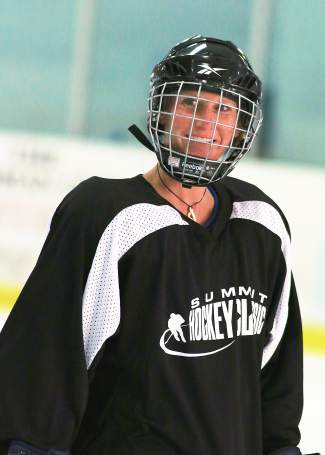 Town of Breckenridge employee Bree Hare smiles between halves at the 2015 Summit Hockey Classic in Breckenridge. The annual event returns to town this season for two days of hockey on April 1-2.