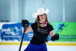 Hockey mom Jenni Bonenberger takes to the ice at intermission between games at the Summit Hockey Classic in Breckenridge on April 1.