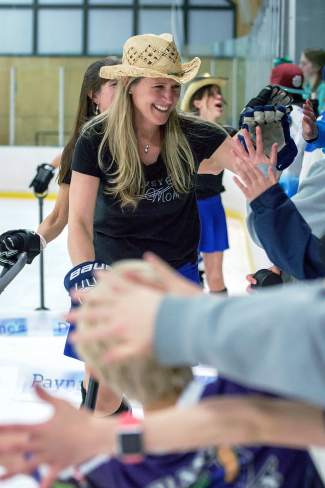The fan favorite hockey moms get high-fives after a performance at intermission for the Summit Hockey Classic on April 2 in Breckenridge.