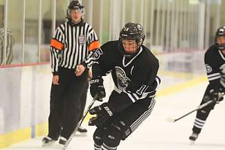 Summit native Beck Moore handles the puck during a game with the Colorado Thunderbirds of Denver. Moore was recently drafted by the Lincoln Stars, a Tier 1 Junior A program in Nebraska, the highest level of U.S. hockey before college and professional.