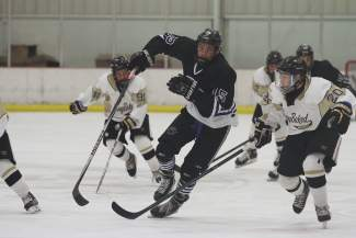 Summit native Beck Moore (center, dark jersey) skates through defenders while playing with the Colorado Thunderbirds, a competetive hockey program based in Denver. Moore was recently drafted by the Lincoln Stars, a Tier 1 Junior A team based in Nebraska.