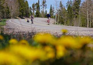 Summit longboarder Jim Bowden (front) charges down a hill in front of Phil Lindeman (middle) and Tim
