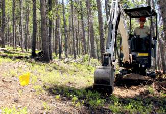 An excavator digs the foundation of a new multi-use trail in the Golden Horseshoe area of Breckenridge. The area was littered with unmarked social trails before the U.S. Forest Service came through and closed many, then reopened more popular ones with help from volunteer crews.