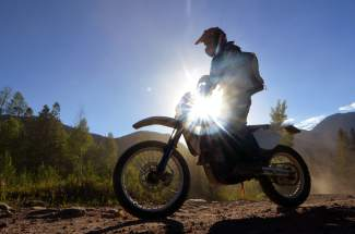 Tim Nixon, president of Summit County Off-Road Riders, finds dusk riding on Miners Creek Road outside of Frisco. The dirt road connects with a half-dozen trails in the area, but few are open to motorized travel and others have recently been closed to it.