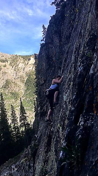 Brigitte Coburn clipping the first bolt on a climb at Officer's Gulch West. The area is home to Hidden Wall, with sport routes from 5.5 to 5.11.