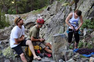 Local climbers Sage Miller (left) and Grant Nelson (center) scope out the routes while Brigitte Coburn gets roped up at Officer's Gulch West. The popular climbing area is found about 10 minutes from Frisco and easily accesible by foot.