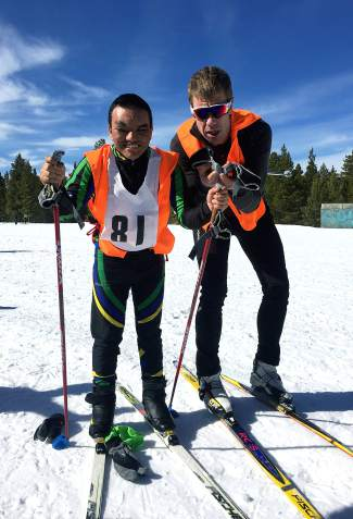 Freshman Nordic skier Will Lewis (left) with Summit High Nordic coach Jonathan Mocatta. Lewis, the only visually-impaired skier on the Summit team, has finished every race of the high school season with the help of an on-course guide.