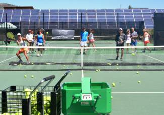 The view from behind the tennis machine during a drop-in clinic at the Breckenridge tennis courts in July. Coaches use the machine to run volley and overhead smash drills.