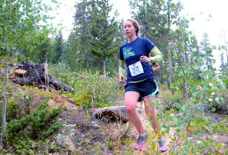 Stephanie Bentz gracefully flies through the air on the Tom's Baby trail during the final race of the Summit Trail Running Series in 2015. The series returns for its 15th season with the French Gulch course at 6 p.m. on June 8.