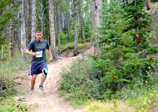Jon Dorr maneuvers through a particularly steep and slippery section of Toms Baby in Breckenridge during the final race of the Summit Trail Running Series on Aug. 26.