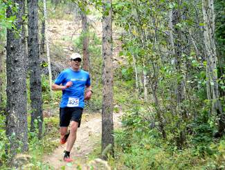 Michael Shambarger cruises down Tom's Baby at the final event of the 2015 Summit Trail Running Series. The series returns for its 15th season with the French Gulch course at 6 p.m. on June 8.