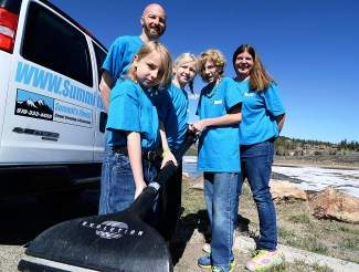 In November Troy Vaille, back left, and his wife, Kendal, back right, launched Summit's Finest Carpet Cleaning & Restoration to provide carpet cleaning, repair and flood restoration services in Summit County. Their kids, Miles, front, Lexi, middle, and Jeremiah also pitch in by helping dad clean the company van after a long day.