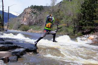 Aaron Ventimiglia of Canon City leaps into Clear Creek as part of a swift water rescue training program. Along with raft guides like Ventimiglia, the Summit County Water Rescue Team trains year-round for emergency rescues on unpredictable local waterways.