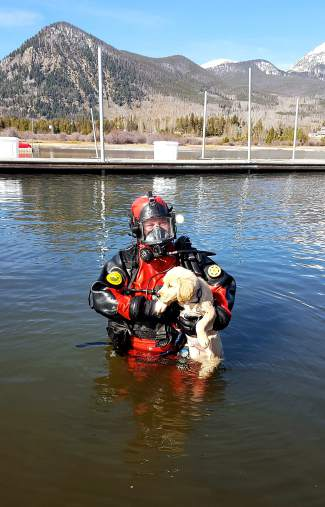 A Summit County Water Rescue Team member practices rescue techniques with a pooch at North Pond Park in Silverthorne. The small, all-volunteer team is supported by the Summit County Sheriff's Office and travels across the Rocky Mountains for rescue and retrieval operations.