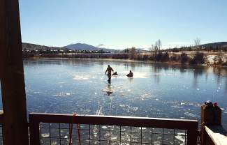 Members of the Summit County Water Rescue Team, a department of the Summit County Sheriff's Office, practice ice rescue techniques on North Pond in Silverthorne. The small organization depends entirely on volunteers for year-round rescues and retrievals on whitewater across the Rocky Mountains.