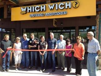 Which Wich owners Seth and Kelsey Lyons and members of the Silverthorne Town Council participate in a ribbon cutting ceremony Friday at The Outlets at Silverthorne. The grand opening was significant because the Lyons were the first to take advantage of Silverthorne's restructured Enhanced Sales Tax Incentive Program.