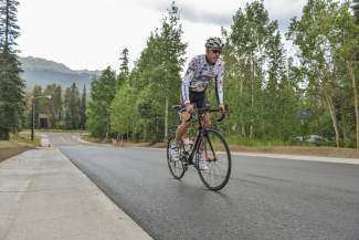 Taylor Shelden pedals up Moonstone Road on an overast and drizzly afternoon just days before the start of the USA Pro Challenge. This year marks the 27-year-old's first appearance in the race after more than five years on the cycling circuit.