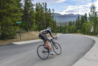 Summit County native Taylor Shelden whips through a corner on Moonstone Road in Breckenridge. The road is the toughest climb of an 8.5-mile time trial on Aug. 21.