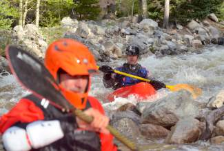 Two kayakers pick their way through the Class IV rapids of Tenmile Creek on June 8. The creek is tight and shallow, which gives it a short yet intense season of no more than four weeks in May and June.