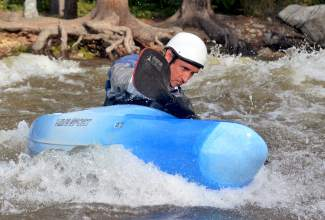 A kayaker paddles to an eddy shortly after dropping into Tenmile Creek from Officer's Gulch, found about 4 miles outside of Frisco. The creek has notoriously short and intense season, with flows reaching 1,000 cubic feet per second on June 9 to earn the tight creek a Class IV rating.