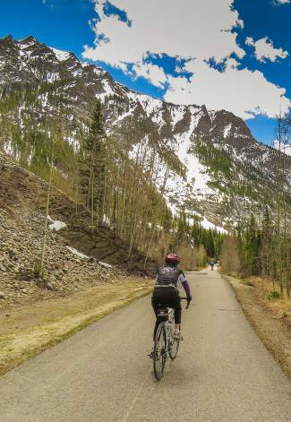 Cyclists pedal up the Tenmile Canyon Recpath between Frisco and Copper on May 20. The county recently opened the recpath when avalanche and flooding danger subsided enough in the past week.