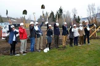 Silverthorne Town Council and Lake Dillon Theatre Company board members and staff pose for the ceremonial shovel in the ground.