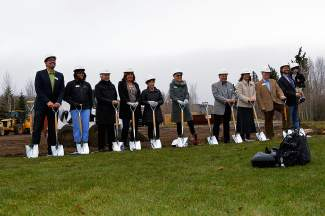 Lake Dillon Theatre Company board members and staff pose for the ceremonial shovel in the ground.
