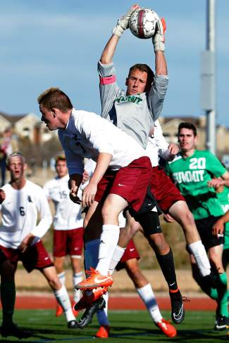 Summit senior Noah Glasco (1) makes a save in front of The Classical Academy sophomore Chris Chasteen (7)  during the Tigers state quarter finals loss.