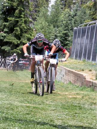 Jamey Driscoll (left) and Chris Baddick (behind) charge to a sprint finish in last summer's 50-mile Firecracker 50 mountain bike race in Breckenridge. Driscoll won by approximately a tire length(0.166 seconds) in the closest finish of the race's 14-year history.