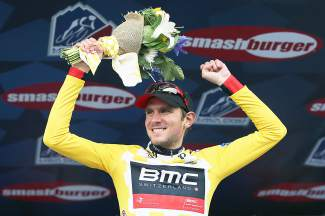 Tejay van Garderen of Aspen celebrates on the podium as he defended the overall race leader's yellow jersey in stage five of the 2014 from Woodland Park to Breckenridge. Van Garderen went on to win his second consecutive Pro Challenge.