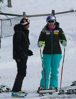 Four-time World Cup champion Lindsey Vonn chats with her coach after a practice run at Copper Mountain in November 2014. It was Vonn's first day on the full-length training course since tearing her ACL there in November of 2013.