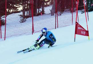 Olympic medalist Lindsey Vonn blasts past a gate during a training session at Copper Mountain Resort earlier in November of 2014. The World Cup skiier had been back on the snow in Colorado rehabilitating her ACL injury from the previous year. She went on to win her first World Cup race since the injury at Lake Louise, Alberta, in December.