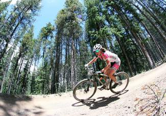 Jennifer Smith charges down the final mile of singletrack above Carter Park in Breckenridge on her way to a first place finish in the pro/open women's division of the Firecracker 50 Friday, July 5, 2014. She finished the race in 4:17:50.39, just under 6 seconds ahead of second place finisher Kelly Boniface.