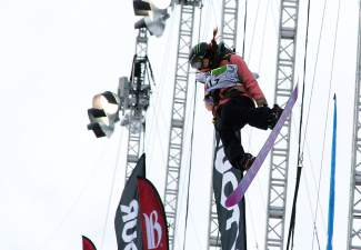 Chloe Kim, 14, airs out of the 2014 Dew Tour halpipe on her way to second place on the podium.