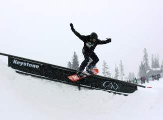 A rider goes for a rail slide in last year's TransWorld TranAm competition at Keystone Resort.