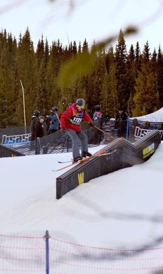 Tyler Black of Bend, Oregon slides through the kink rail on the slopestyle course during the youth boy's final at the 2016 USASA National Championships of skiing on April 12.