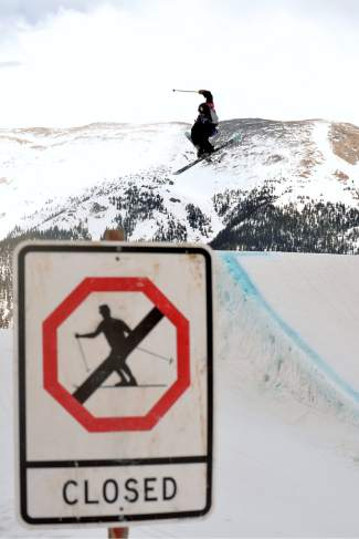 Luke Ryder of North Conway, New Hampshire spins over the first hit on the slopestyle course during the youth boy's final at the USASA National Championships for skiing in Copper on April 12.