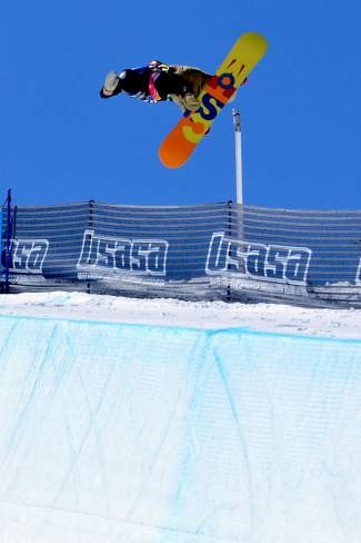 Robert Pettit of basalt spots his landing in the halfpipe during the men's open division qualifier at the USASA National Championships in Copper on April 7.