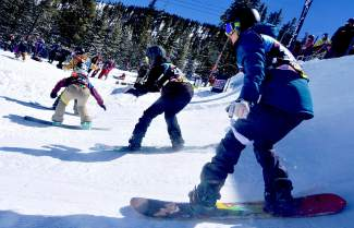 A group of four boardercross racers in the Breaker girls division (12-13 years old) drop into the opening quarterpipe hit on the USASA National Championship course for a qualifier on April 6.