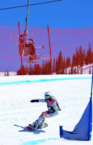A lone racer breaks ahead of the pack early in a boardercross qualifier for the USASA National Championships at Copper Mountain on April 6.